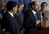 "Nihad Awad (2nd R), Executive Director of the Council on American-Islamic Relations (CAIR), speaks alongside leaders of the Muslim community about the growing ""Islamophobia"" in the United States during a press conference at the National Press Club in Washington, DC, December 21, 2015. AFP PHOTO / SAUL LOEB / AFP PHOTO / SAUL LOEB"